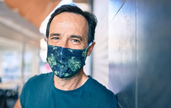 Middle age man with beard wearing coronavirus safety mask