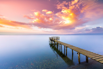 sunset on the pier. Wooden sea pier with sunset and fantastic clouds in the sea. Iznik, Bursa, Turkey
