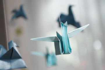 Hanging blue Origami birds for children's or baby room and crib.