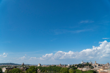 Beautiful Rome skyline. Scenic panorama of the historical center of Rome. Ancient city of Roma from above on a sunny day