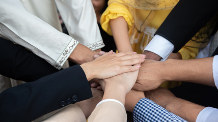 Teamwork diversity business people join hand together for successful goal setting.