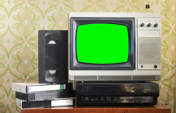 Old silver vintage TV with green screen to add new images to the screen, VCR on wallpaper background.