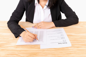 Young woman taking test in job assessment table.