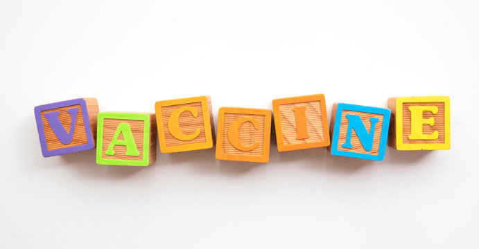 Vaccine word made from colourful wooden baby development blocks