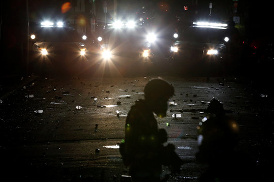 Objects thrown by demonstrators litter a street during a protest against police violence and racial injustice in Portland