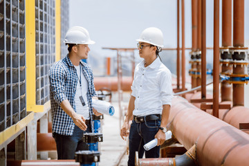 Construction engineer checking air condition machine at new site building. Construction engineer worker concept.