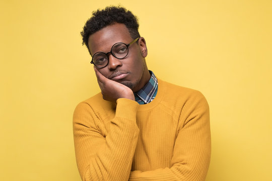 Unhappy frustrated young african man having puzzled expression