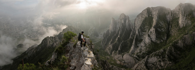One man standing on a narrow edge at a high area in La Huasteca