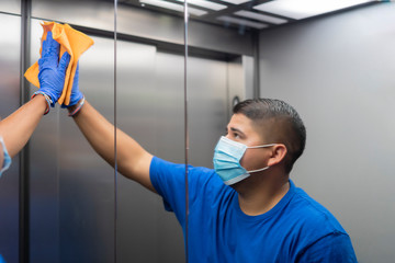 cleaning professional thoroughly disinfecting the elevator