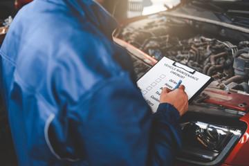 Car mechanic inspecting vehicle. Auto inspection concept