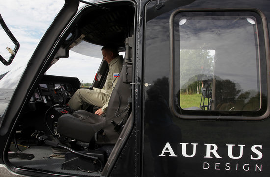 A man sits inside the cockpit of an Ansat Aurus luxury helicopter at Kazan Helicopter Plant in Kazan