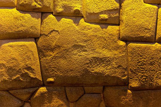 The twelve angle stone at night in the Hatun Rumiyoc street, Cusco, Peru.