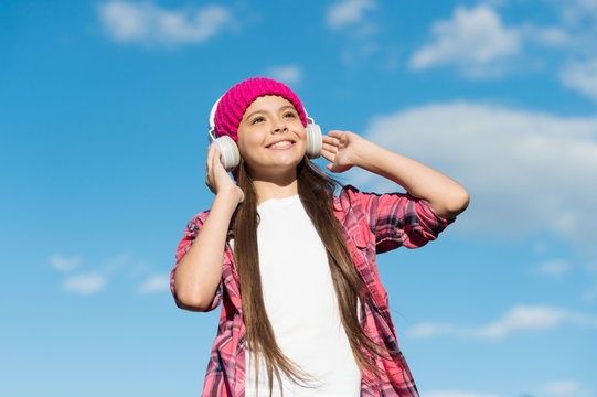 Fly high with english. Happy kid listen to music on sunny blue sky. Audio learning. Listening comprehension skills. English school. Foreign language courses. Active listening. Learn and enjoy