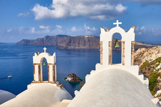 Bell tower with santorini caldera views in Oia
