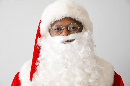 African-American Santa Claus on light background