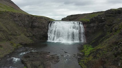 Wall Mural - Flying towards the Thorufoss waterfall in Iceland