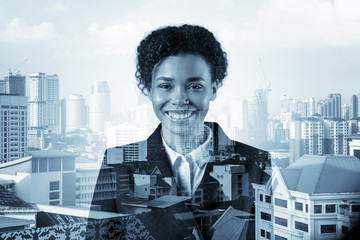 Successful smiling black African American business woman in suit. Kuala Lumpur cityscape. The concept of woman in business. KL skyscrapers. Double exposure.