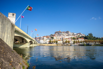 Wall Mural - Coimbra cityscape with Santa Clara Bridge over Mondego river,  Portugal