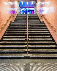 A set of stairs looking up from the Flinders Street Station underpass to Degraves Place in the Centre of Melbourne, Australia