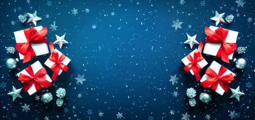 Christmas gift boxes and snowflakes on blue background