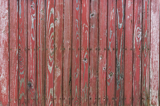 old wooden wall with red planks
