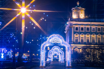 Saint Petersburg in the evening. Russia in winter. Festive lights of Petersburg. Decorations of city streets for Christmas. New year in Petersburg. Luminous arches of garlands. Waiting for the holiday Fotomurales