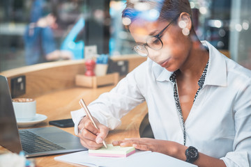 Business woman working behind glass stock photo