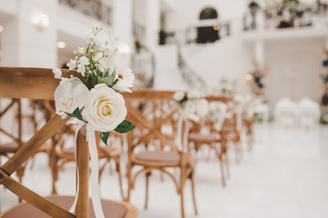 Decorations for wedding ceremony. Flower set up on chair