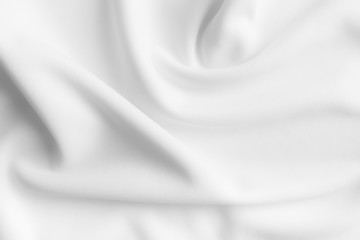 White abstract wavy clothes background. fabric texture