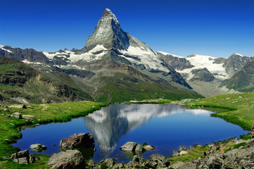 Wall Mural - Matterhorn and its reflection in a lake