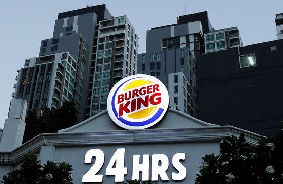 A Burger King logo is seen outside a restaurant in Bangkok