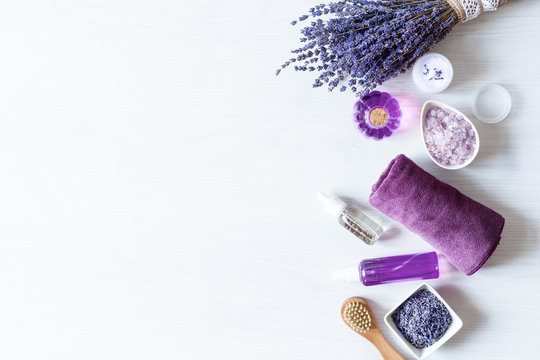 Variety of organic lavender cosmetics on white background top view.