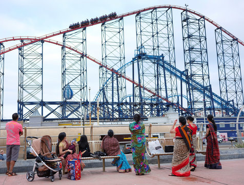 People watch the 'Big One' rollercoaster as they stand on the promenade following the outbreak of the coronavirus disease (COVID-19) in Blackpool