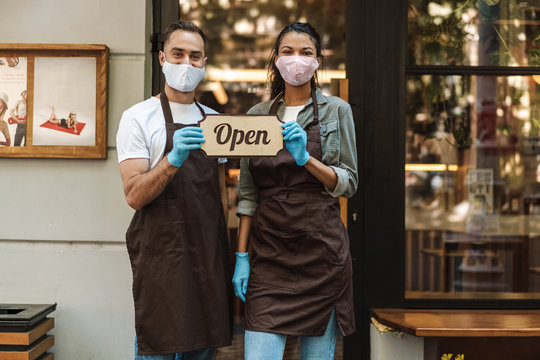 Man and woman coffee shop owners