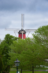 Fototapeta Windmill in Leiden, Netherlands decorated with the Duch flag obraz