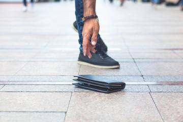 man hand wallet in street floor background