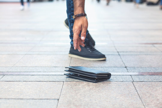 man hand wallet in street floor background