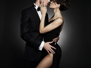 Photo sur Plexiglas womenART Fashionable photo of beautiful naked lady and man in suit.