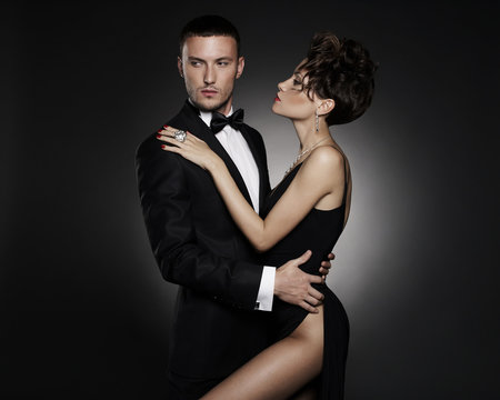 Fashionable photo of beautiful naked lady and man in suit.