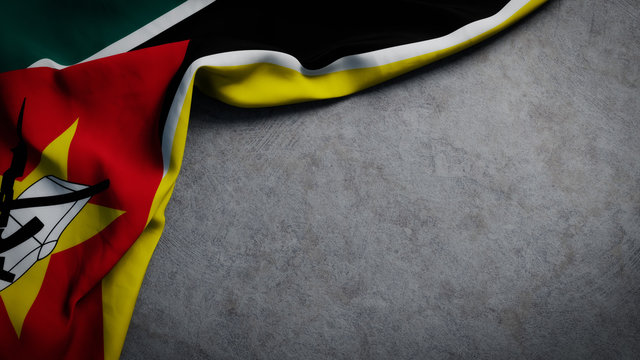 Flag of Mozambique on concrete backdrop. Mozambique flag background with copy space