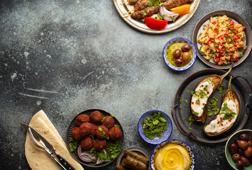 Printed roller blinds London Middle eastern or Mediterranean dinner with grilled kebab, falafel, roasted and fresh vegetables, assorted Arabic meze and appetizers on rustic background table. Dinner table overhead, space for text