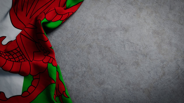 Flag of Wales on concrete backdrop. Welsh flag background with copy space