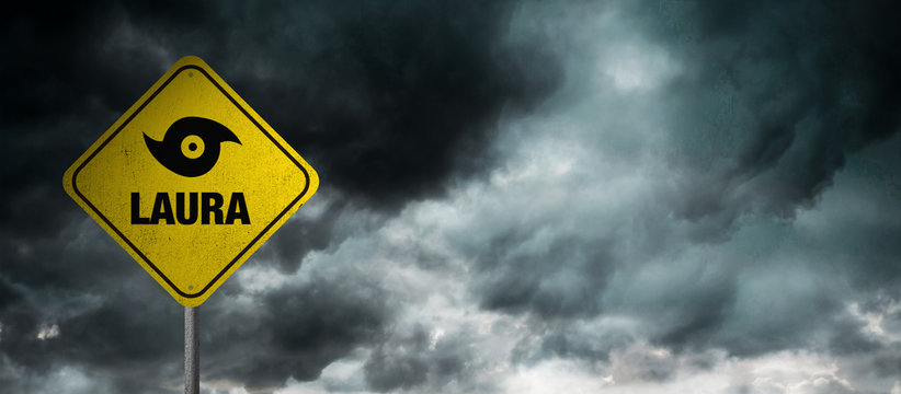 Hurricane Laura banner with storm clouds background.