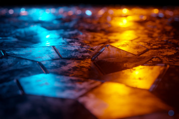Blue and orange glowing hexagons background pattern on textured metallic surface 3D rendering