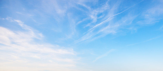 View of the blue sky with white clouds. Heavenly beauty. For wallpapers, backdrops and covers.