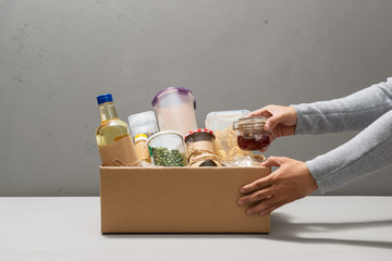 People make out products of box isolated on gray