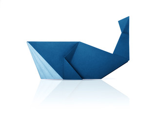 Photo of paper origami marine blue whale isolated on a white