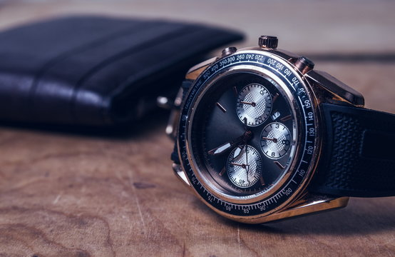 Business wristwatch on the wooden table
