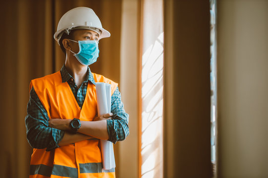 Portrait of industrial engineer man wears protective mask in office for prevention COVID-19 virus to stop spreading.