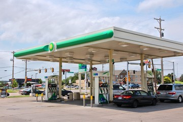 GOODLAND, KS, USA - JUNE 25, 2013: People fill their tanks at BP gas station in Goodland, Kansas, USA. BP had 31.3 billion USD operating income in 2013.